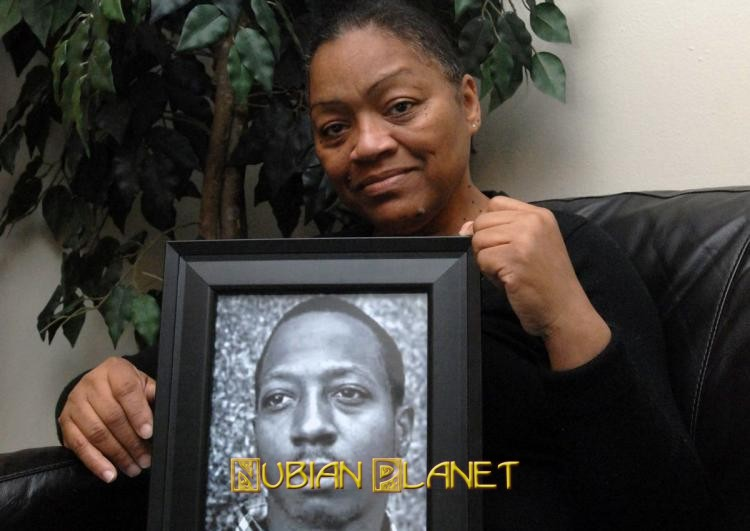 Venida Browder holds a picture of her son Kalief who killed himself