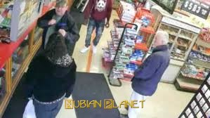 woman punches racist white man on floor in store